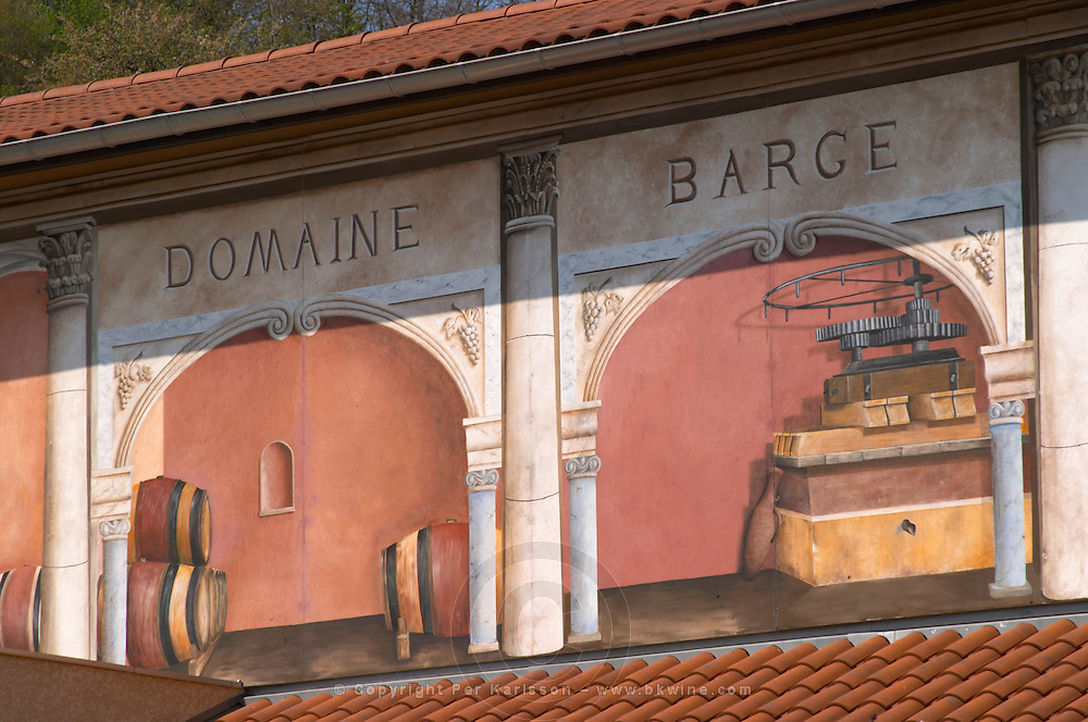 The winery at Domaine Barge with wall fresco paintings showing barrels and a wine press in old roman style. Ampuis, Cote Rotie, Rhone, France, Europe