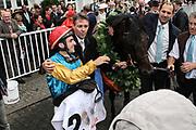 Pferdesport: 148. Deutsches Galopp Derby, Hamburg, 02.07.2014<br /> Jubel von Sieger Maxim Pecheur und Windstoß <br /> © Torsten Helmke