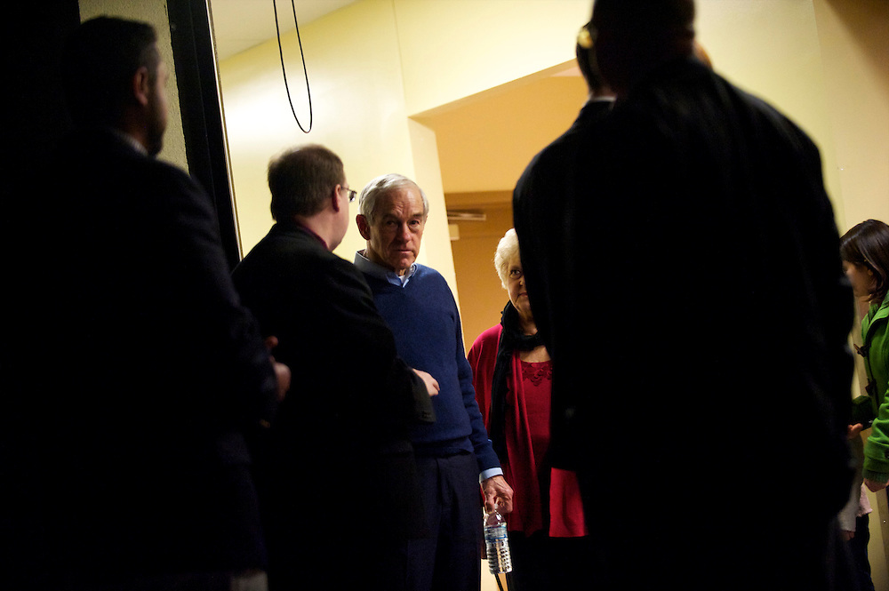 Republican Presidential candidate RON PAUL confers with staff and wife Carol (pink) after delivering a speech at the Palisades Conference Center.  The South Carolina primary will be held on January 21st.