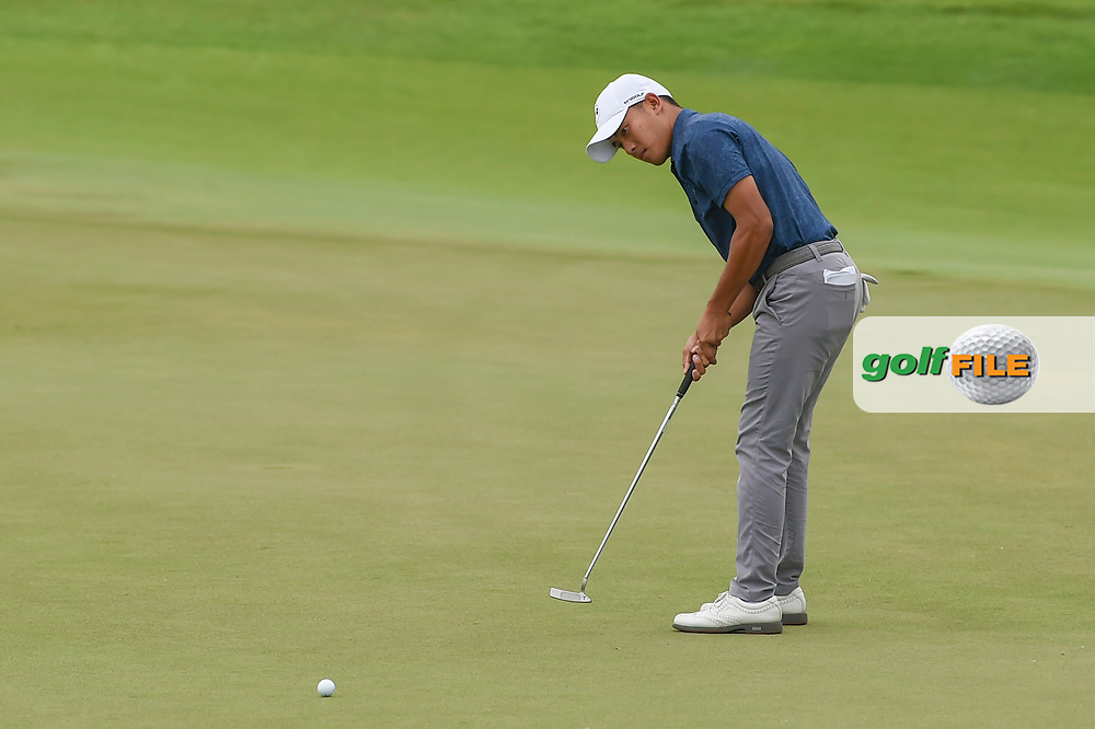 Lloyd Jefferson GO (PHI) watches his putt on 18 during Rd 4 of the Asia-Pacific Amateur Championship, Sentosa Golf Club, Singapore. 10/7/2018.<br /> Picture: Golffile | Ken Murray<br /> <br /> <br /> All photo usage must carry mandatory copyright credit (© Golffile | Ken Murray)