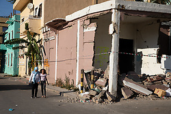 © Licensed to London News Pictures. 16/08/2020. Beirut, Lebanon. Children walk past a smashed building in the Karantina district of Beirut which has been badly destroyed following the huge explosion in Beirut Port on 4 August. Photo credit : Tom Nicholson/LNP