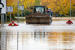 South Yorkshire flooding. Ickles Roundabout Rotherham. Specialist rescue teams from the West Midlands Fire service assits with the recovery of a stranded Scania lorry and its driver as they rescue people from vehicles and business premises along the A6178 Sheffield Rd<br /> <br />  Copyright Paul David Drabble<br />  07 November 2019<br />  www.pauldaviddrabble.co.uk