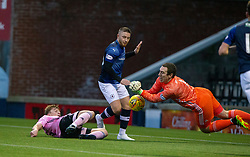 Peterhead's keeper Greg Fleming saves from Raith Rovers John Baird. Raith Rovers 2 v 1 Peterhead, Scottish Football League Division One played 4/1/2020 at Stark's Park, Kirkcaldy.