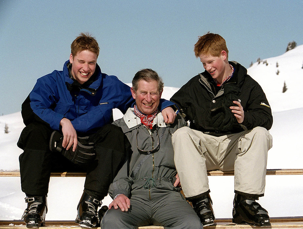 Prince Charles, The Prince of Wales with his sons Prince William and Prince Harry on a ski holiday.They are seen at Madrisa in Klosters, Switzerland.2000 Photographed by Terry Fincher.