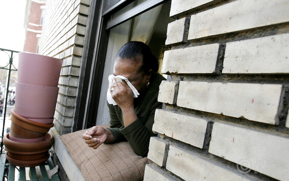 Maria Perez, of the Bronx, cries while watching the funeral services for the ten people killed in a house fire at the Islamic Cultural Center across the street in the Bronx, New York on Monday, 12 March 2007. ..