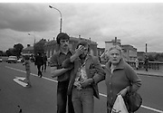 H-Block Protest To British Embassy.  (N86)..1981..18.07.1981..07.18.1981..18th July 1981..A protest march to demonstrate against the H-Blocks in Northern Ireland was held today in Dublin. After the death of several hunger strikers in the H-Blocks feelings were running very high. The protest march was to proceed to the British Embassy in Ballsbridge...Image shows one of the protesters who was injured in the confrontation with the Gardaí at the protest march being led away.