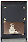 old photo album page with toddler and missing image