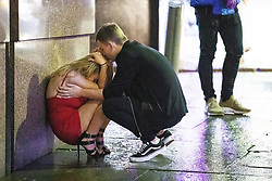 "© Licensed to London News Pictures . 22/12/2018 . Manchester , UK . A man comforts a woman after a fight breaks out outside The Birdcage nightclub on Withy Grove . Revellers out in Manchester City Centre overnight during "" Mad Friday "" , named for historically being one of the busiest nights of the year for the emergency services in the UK . Photo credit : Joel Goodman/LNP"