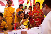 Families from the Dobhanda Nagar slum in Cuttack get legal advice and birth certificates from the Urban Law centre run by the organisation CLAP, Committee for Legal Aid to Poor, helps provide legal aid to the poorer communities in the Orissa district of India.