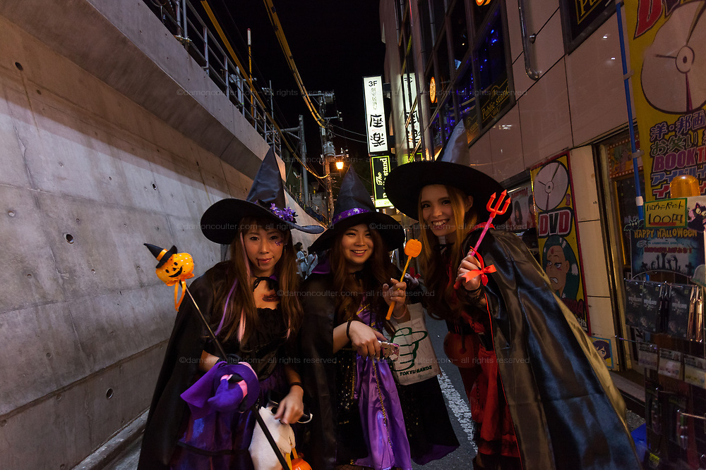 Three young Japanese women dressed in witch costumes during the Halloween celebrations in Shibuya, Tokyo, Japan. Wednesday October 31st 2018 .  Halloween has grown massively popular  in Japan over the last few yers. Primarily an event for young adults who use it as a chance to dress up in inventive costumes and spend the night partying . In recent years the misbehaviour of some revellers has caused a heavier police presence on the street and  a push back from the Japanese society, and media  who see no need for nor benefits to this western cultural import.