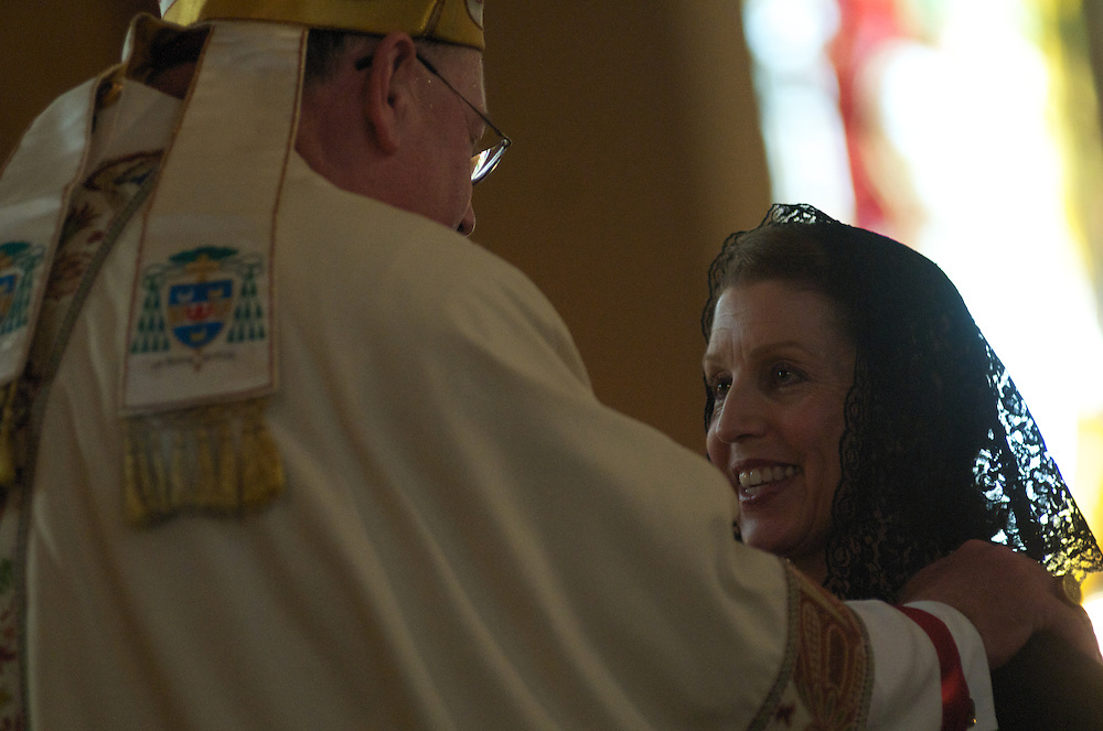 Celebrant Archbishop Dolan invests a Lady Candidate during the Ceremony of Investiture, Sunday Oct. 12 2008. Those Invested included 31 Knights, 29 Ladies, seven Priest Knights, and four Bishop Knights.