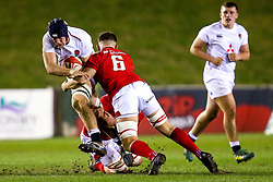 Alex Coles of England U20 is tackled - Mandatory by-line: Robbie Stephenson/JMP - 22/02/2019 - RUGBY - Zip World Stadium - Colwyn Bay, Wales - Wales U20 v England U20 - Under-20 Six Nations