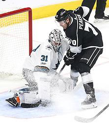 San Jose Sharks  beats Los Angeles Kings 2-1 in NHL hockey game ..Los Angeles Kings' forward Tanner Pearson (R) shoots as San Jose Sharks' goalie Martin Jones defends during a 2017-2018 NHL hockey game in Los Angeles, the United States, on Nov. 12, 2017.  San Jose Sharks won 2-1. (Credit Image: © Zhao Hanrong/Xinhua via ZUMA Wire)