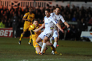 Newport's Ryan Burge is fouled by Wimbledon's Darren Jones. Skybet league 2 match, Newport county v AFC Wimbledon match at Rodney Parade in Newport, South Wales on Tuesday 25th Feb 2014.<br /> pic by Andrew Orchard, Andrew Orchard sports photography.