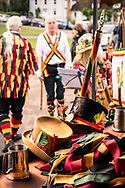 Traditional Morris dancing in Brockham in England UK. The burning of the sticks represents the end of the dancing season where the sticks are thrown into the fire for rebirth next Spring. Morris dance is a form of English folk dance usually accompanied by music. It is based on rhythmic stepping and the execution of choreographed figures by a group of dancers, usually wearing bell pads on their shins. Implements such as sticks, swords and handkerchiefs may also be wielded by the dancers.