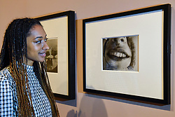 "© Licensed to London News Pictures. 19/11/2019. LONDON, UK. A staff member views ""Untitled (Grotesque)"", c1935, by Dora Maar. Preview of the first UK retrospective of Dora Maar (born Henriette Theodora Markovitch, 1907-97) whose photographs and photomontages became celebrated icons of surrealism.  Over 200 of her works are on display in a career spanning more than six decades at Tate Modern 20 November to 15 March 2020.  Photo credit: Stephen Chung/LNP"