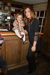 TAMARA ECCLESTONE and her daughter SOPHIA at a party to celebrate the publication of The Stylist by Rosie Nixon held at Soho House, London on 10th February 2016.