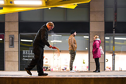 "© Licensed to London News Pictures . 16/12/2017. Manchester, UK. A night worker grits the ground at Exchange Square tram stop as temperatures drop to below freezing . Revellers out in Manchester City Centre overnight during "" Mad Friday "" , named for historically being one of the busiest nights of the year for the emergency services in the UK . Photo credit: Joel Goodman/LNP"