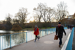 © Licensed to London News Pictures. 02/02/2015. LONDON, UK. Commuters walking through St. James's Park on Monday, 2 February 2015. Photo credit : Tolga Akmen/LNP