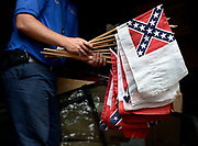 The Woodlawn National Cemetery caretaker, Dave Swarthout, holds a collection of Confederate flags collected from the Confederate War time graves and stored in a shed, at the cemetery in Elmira, N.Y., Thursday, July 9, 2015. The House faces a revote on a Confederate flag ban on federal cemeteries. <br /> (AP Photo/Heather Ainsworth)