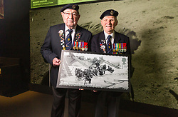 D-Day veterans Leading Stoker, Royal Navy, Fred Lee, 93 and Radar Operator Leonard Hobbs, 94, pose with an enlarged Royal Mail D-Day commemorative stamp at the National Army Museum in Chelsea, London. The stamps will be released on 2nd June. London, May 22 2019.