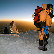 Phuru Sherpa at Mushroom Rock (28,300 feet) on Everest's Northeast Ridge at sunrise on May 30, 2003.