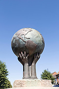 War memorial sculpture showing the world held by hands, Royal Wootten Bassett, Wiltshire, England, UK