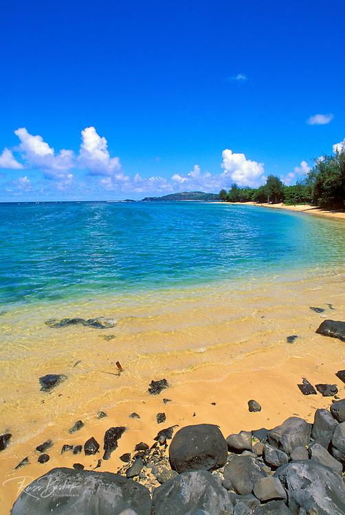 Blue Pacific waters and white sand at Anini Beach, North Shore, Island of Kauai, Hawaii USA
