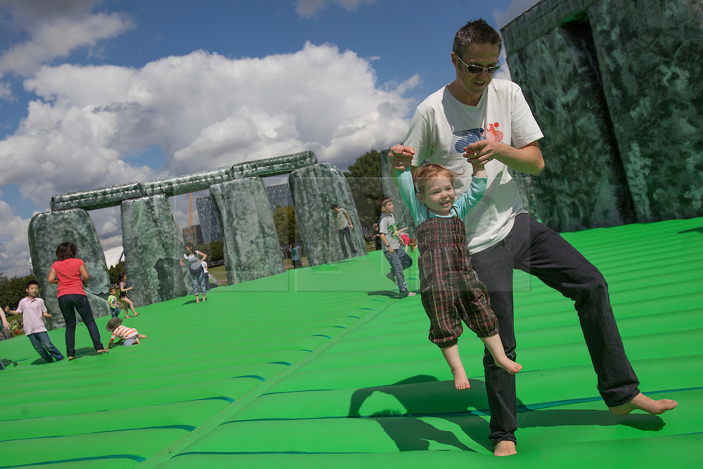 © licensed to London News Pictures. London, UK 21/07/2012. Families enjoying Jeremy Deller's life-size bouncy castle version of Stonehedge, entitled Sacrilege which comes to London as a part of the London 2012 Festival on 21/07/12. Photo credit: Tolga Akmen/LNP
