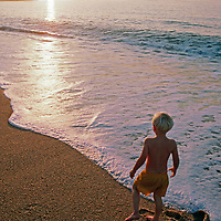 A youngster plays on a beach by Half Moon Bay.