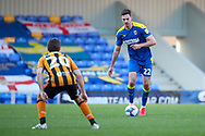 AFC Wimbledon defender Ben Heneghan (22) about to pass the ball during the EFL Sky Bet League 1 match between AFC Wimbledon and Hull City at Plough Lane, London, United Kingdom on 27 February 2021.