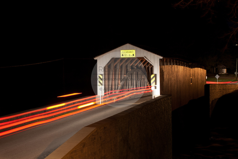 Streaks of tail lights pass through Forry's Mill Covered Bridge at night West Hempfield Township, PA