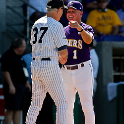 06 June 2009:  LSU head coach Paul Mainieri greets Rice head coach Wayne Graham prior to the start of a 5-3 victory by the LSU Tigers over the Rice Owls in game two of the NCAA baseball College World Series, Super Regional played at Alex Box Stadium in Baton Rouge, Louisiana. The Tigers with the win advance to next week's College Baseball World Series in Omaha, Nebraska.