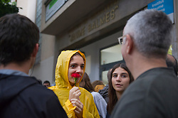 "© Licensed to London News Pictures. 01/10/2017. Barcelona, Spain.  <br /> <br /> A student is waiting early in the morning the opening of the Jaume Balmes´ institute, hanging a flower.<br /> <br /> Students, their parents, associations and neighbours have organized to carry out ""playful activities"" during the weekend and keep open the Jaume Balmes´ institute.<br />  <br /> Since early in the morning dozens of people wait at the college´s door for the voting time under the rain.<br /> <br /> Mossos d´Escuadra said they won´t do nothing if that can destabilize social order.<br /> <br /> Catalonia is awaiting for today, October 1st, when the Spanish Region wants to vote in a self-determination referendum to get a independence.<br /> <br /> The Referendum´s Law was passed on last September 6th at the Catalonian Parliament thanks to the votes of ""Junts pel Sí"" and ""CUP"". Then it was suspended by the Spanish Constitutional Court, on next day.<br /> Carles Puigdemont, the President of the Government of Catalonia, said he would ignore that and he and his Government will continue with the Referendum.<br /> <br /> The Spanish Government has sent to Catalonia thousands of ""Guardia Civil"" and ""Policía Nacional"" officers (two of the Spanish forces and state security forces), to enforce the ruling of the Constitutional Court and avoid the voting process on next Sunday. They will work with the Mossos d´Escuadra (the Autonomic police in Catalonia).<br /> <br /> To avoid the vote, the Spanish Government has prevented the opening of polling stations, some of which are schools.  <br /> <br /> Photo credit: Gustavo Valiente/LNP"