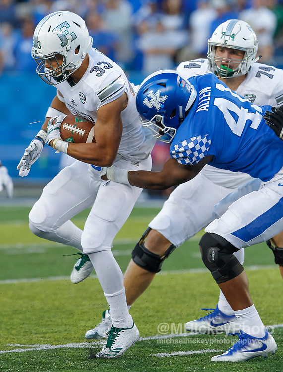 LEXINGTON, KY - SEPTEMBER 30: Breck Turner #33 of the Eastern Michigan Eagles runs the ball as Josh Allen #41 of the Kentucky Wildcats grabs him for the stop at Commonwealth Stadium on September 30, 2017 in Lexington, Kentucky. (Photo by Michael Hickey/Getty Images) *** Local Caption *** Breck Turner; Josh Allen
