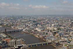 © Licensed to London News Pictures. 13/06/2016. LONDON, UK.  An aerial view of London showing St Paul's Cathedral and the River Thames during sunny spring weather today. Haze and pollution is seen hanging towards the horizon.  Photo credit: Vickie Flores/LNP