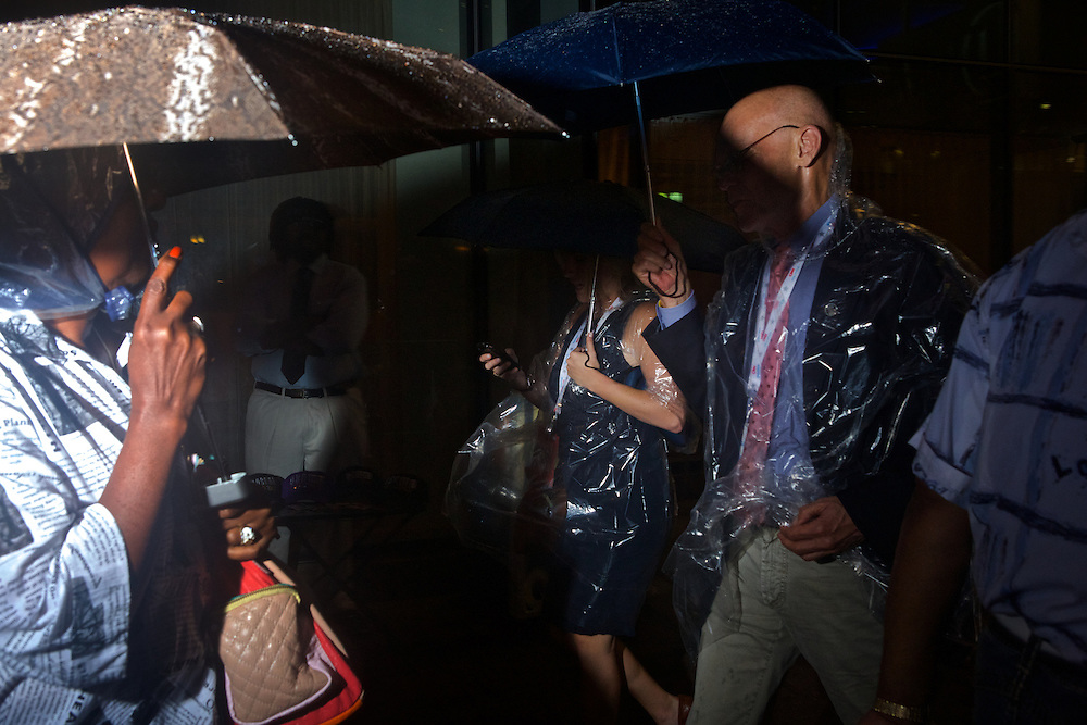 Political commentator James Carville, right, walks through the rain to get to the site of the 2012 Democratic National Convention on Tuesday, September 4, 2012 in Charlotte, NC.