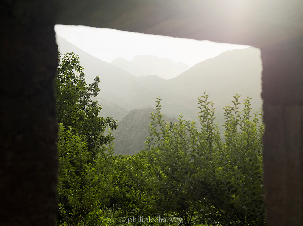A view of the mountains of Toubkal National Park from a window of a Berber home in the Imlil Valley, Morocco