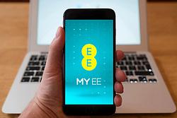 Using iPhone smartphone to display homepage of My EE mobile phone operator website