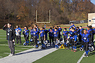 Newburgh, New York - Middletown players and coaches stand during the National Anthem before playing Goshen in the Orange County Youth Football League Division II Super Bowl at Newburgh Free Academy on Nov. 22, 2014.