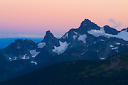 The Cowlitz Chimneys are visible at sunset from the Wonderland Trail, just above Sunrise in Mount Rainier National Park, Washington.