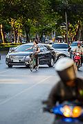 01 APRIL 2013 - BANGKOK, THAILAND: Amy Hupe cuts through Bangkok traffic on a bicycle.    PHOTO BY JACK KURTZ