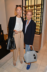 Left to right, ROBERTA BENTELER and HANNELI RUPERT at a lunch hosted by Alice Naylor-Leyland and Tamara Beckwith in celebration of the Coach 2015 collection held at Coach, New Bond Street, London on 18th September 2014.