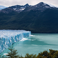 """The Glacier of Perito Moreno is feeded by the Southern Patagonian icefield, an impressive ice mass also called """"Campo de Hielo Sur"""", the second largest icefield in the world. Compared to the nearly 60 meter high ice walls of Perito Moreno, every ship appears to be a floating toy boat."""