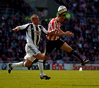 Photo: Jed Wee.<br />Sunderland v Newcastle United. The Barclays Premiership. 17/04/2006.<br /><br />Sunderland's Tommy Miller (R) wins the ball from Newcastle's Lee Clark.