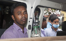 July 4, 2017 - Dhaka, Bangladesh - July 04, 2017- Gazipur, Bangladesh- Relatives received Aminul body form the Gazipur Sadar hospital on July 4, 2017, after a boiler explosion at the complex on the outskirts of Dhaka. At least 10 people were killed and three remained missing on the second day of a boiler explosion incident at a garment factory in Bangladesh, officials said Tuesday. © Monirul Alam (Credit Image: © Monirul Alam via ZUMA Wire)