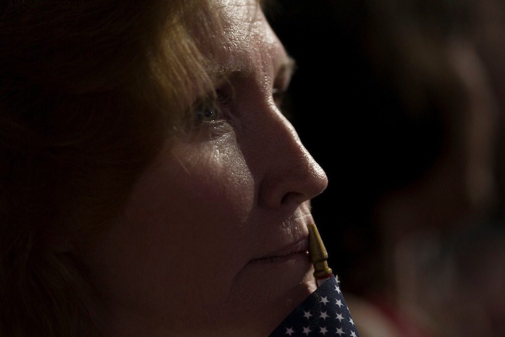 Spectators as Mitt Romney speaks at the RNC in Tampa, FL, on Thursday, Aug. 30, 2012. ..Photograph by Andrew Hinderaker.
