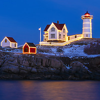 Nubble Lighthouse with Holidays Decoration taken at sunset in York, Maine. Loved watching this sunset burst into colors and capturing the Christmas Lights while the last light of the day created a beautiful sky across one of Maine's most iconic Christmas light scenes.<br />