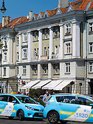 Taxis await passengers along Vokieciu Street/Gatve, Vilnius, Lithuania