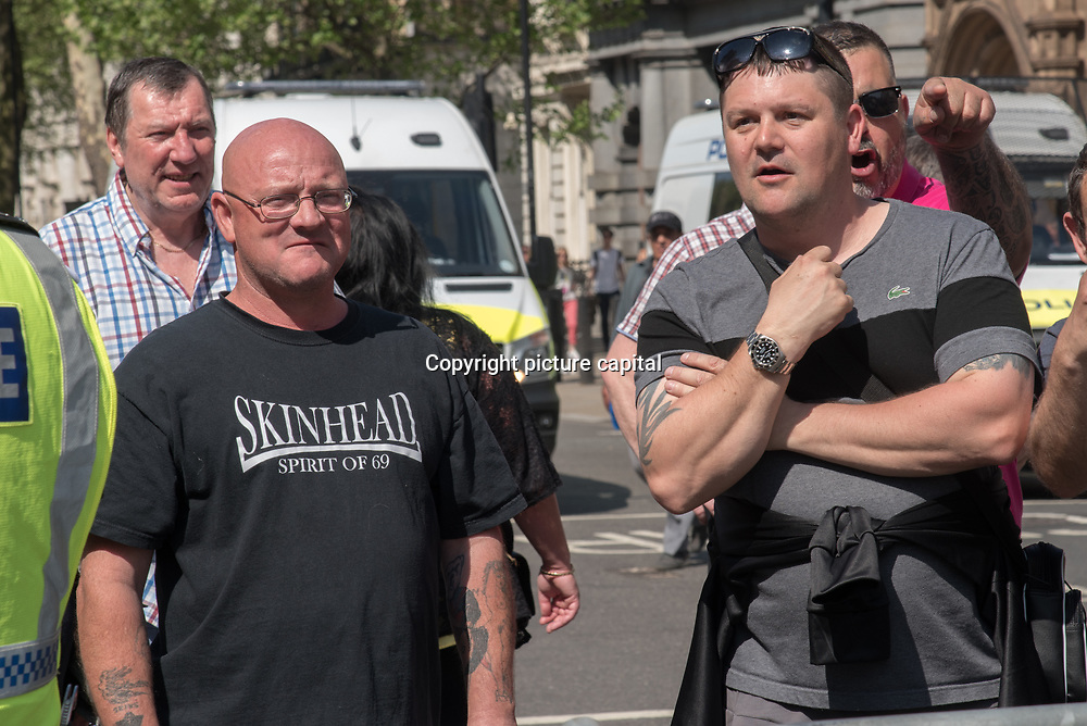 """Anti-Fascist gathered at Whitehall Oppose Tommy Robinson & the """"Democratic"""" Football Lads Alliance, demonstration and a few British Nationalists cross the anti-fascist line and been chased away  on 6 May 2018, London, UK"""